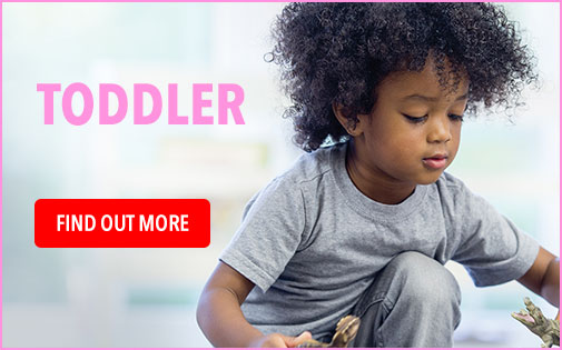 TODDLER WITH AFRO PLAYING